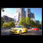 Yellow Taxi Collins street Melbourne Victoria Australia
